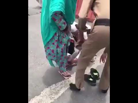 A Saudi police offered his shoes to an old pilgrim who seems to bearing heat on her feet.